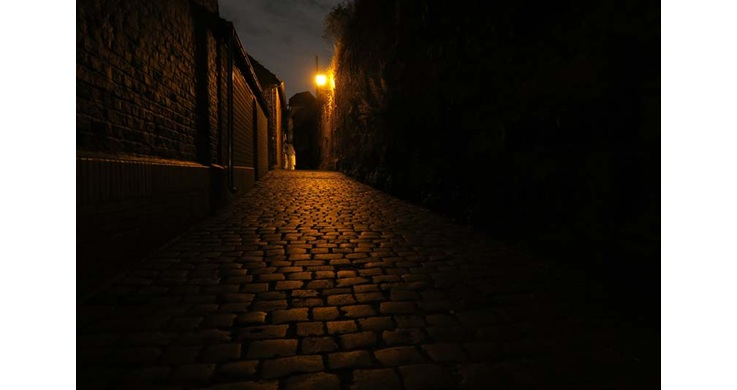 Image of a narrow pathed street at night taken with the Canon PowerShot G7X digital compact camera